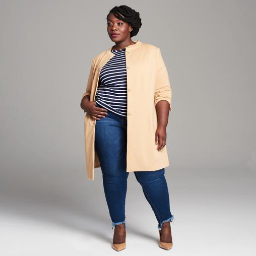 Dia Stylist Christine wearing denim, a plus size car coat, and striped tee.