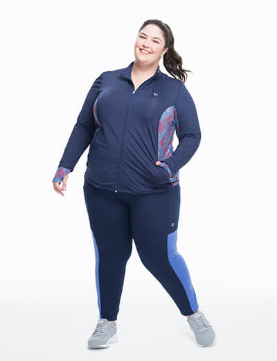 Eleven by Venus Williams in plus size blue leggings and zip-up top