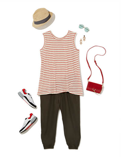 One of many casual outfits available at Dia&Co, this plus size outfit features black plus size joggers, a striped sleeveless top, sneakers, and a red purse.