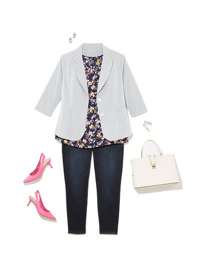 One of many classic outfits available at Dia&Co, this plus size outfit features a light blue blazer, dark jeans, floral top, and pink heels.