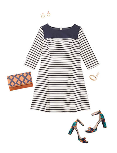 This preppy style outfit features a navy striped dress, floral heels and clutch.