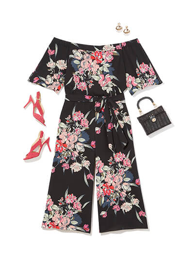 This glam outfit features a floral jumpsuit and red heels.