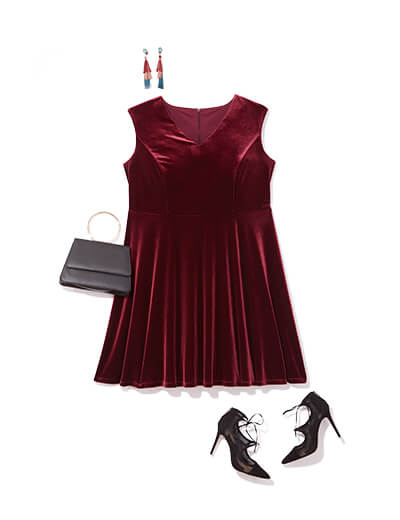 This glam outfit features a red velvet dress, bold dangly earrings and playful pumps.