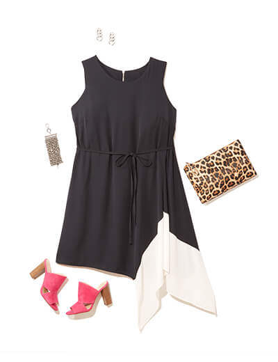 This glam outfit features a black and white dress, cheetah print clutch, and red heels.