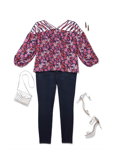 This glam outfit features a cutout floral top and dark denim.