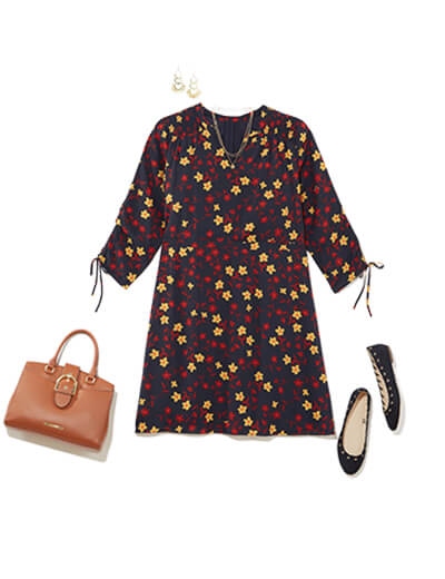 Featuring traditional style, this outfit features a printed dress with a three-quarter length sleeve, paired with flats and a work bag.