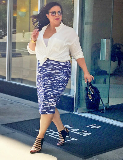rosaliz jimenez in a plus size white button up and blue skirt