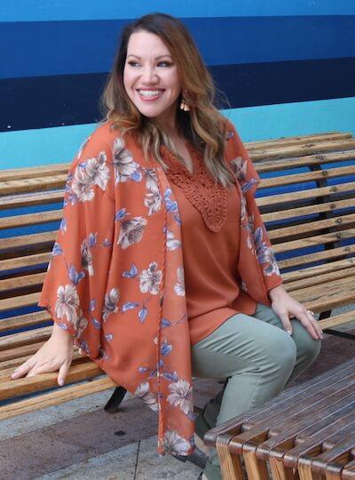 Blogger Angela Cruz in a rust colored kimono.