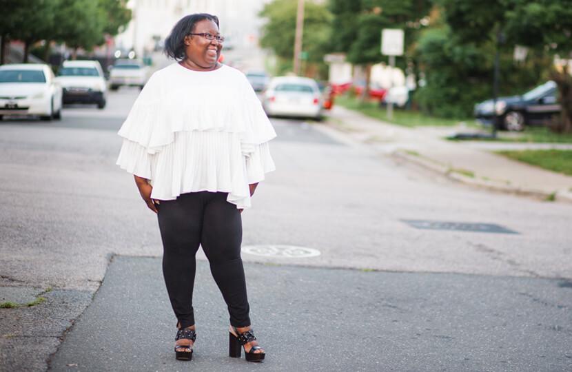 plus-size style evolution white flowy top black pants street style
