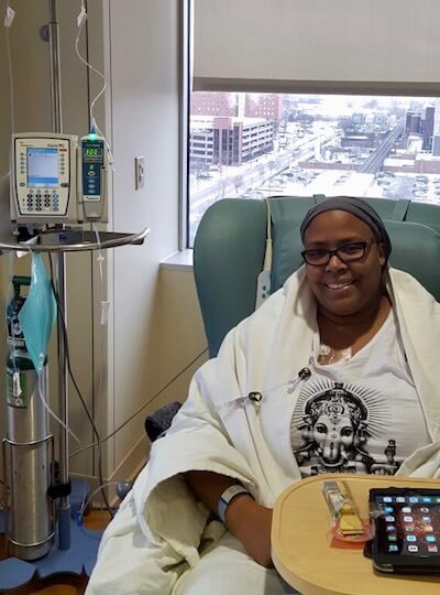 Bisa in a doctor's room, during her cancer battle