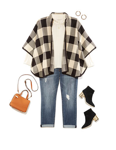 Winter outfit featuring turtleneck under checkered cape.