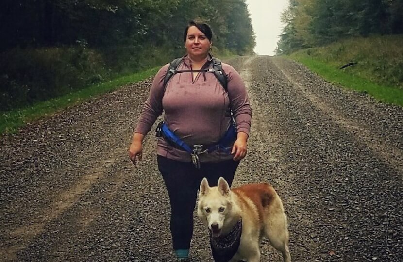 Andrea DiMaio on a hike with her dog, Rammu.