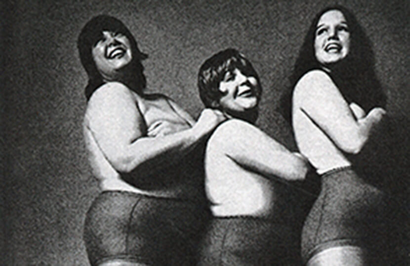 plus-size fashion history three women in tights