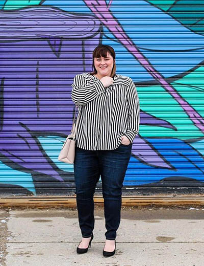 plus-size outfit photos striped shirt black jeans graffiti wall