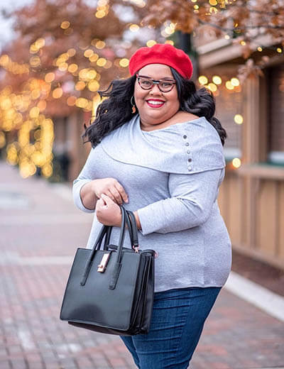plus-size outfit photos off-the-shoulder grey sweater skinny jeans black purse red beret