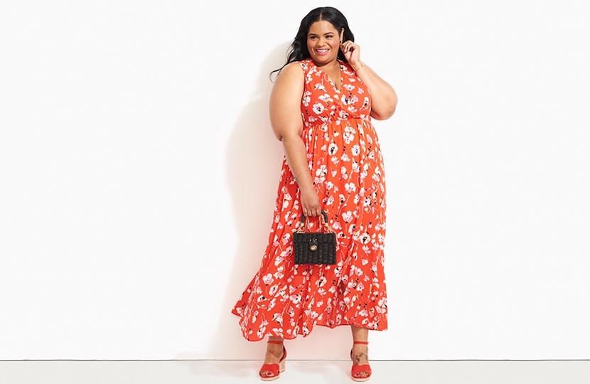 plus size model in red floral maxi dress