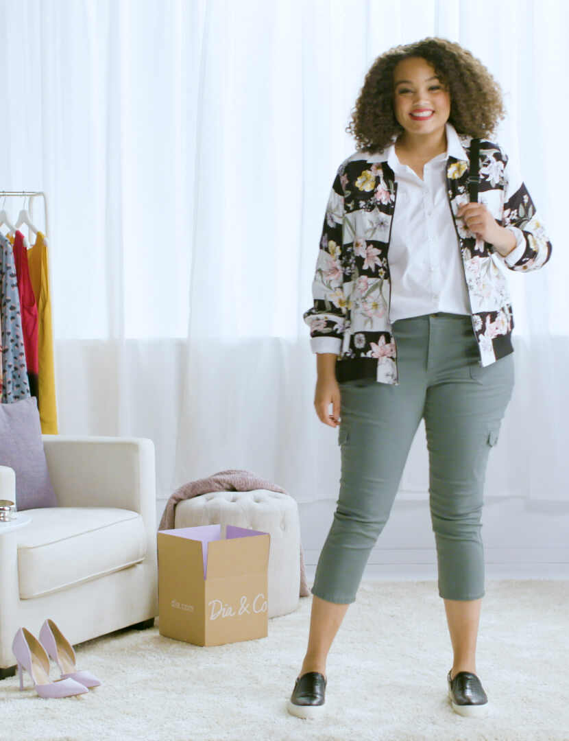 plus-size button-up printed bomber jacket green pants black and white slip-ons