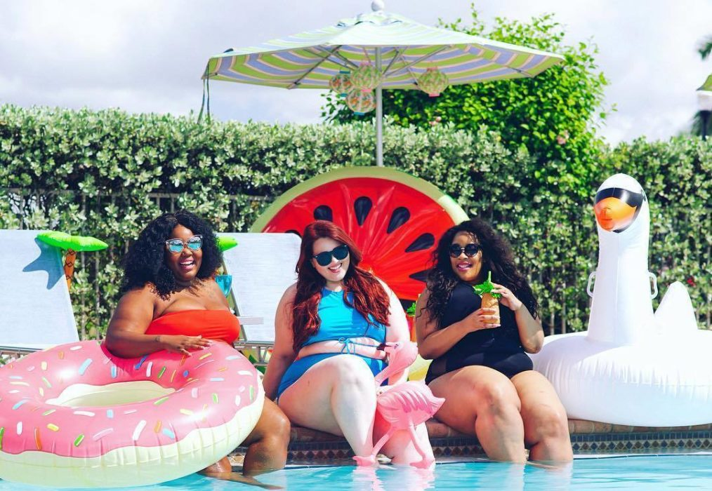 plus size pool party three women and pool floats