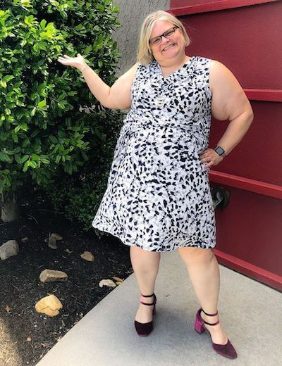 woman in plus size printed sleeveless dress