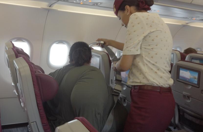 5X passenger on a plane