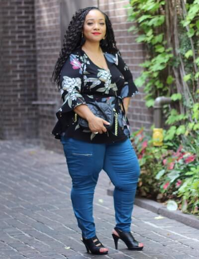 plus size floral wrap top and teal skinny jeans