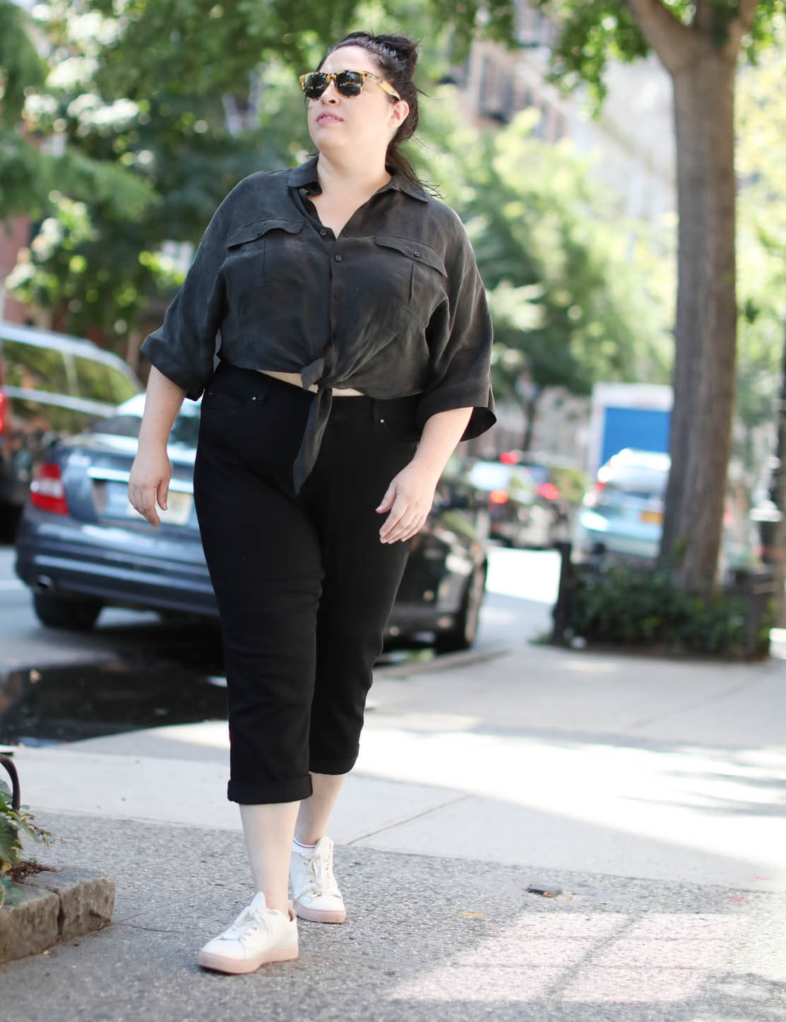 sarah in black plus-size jeans and a black button up
