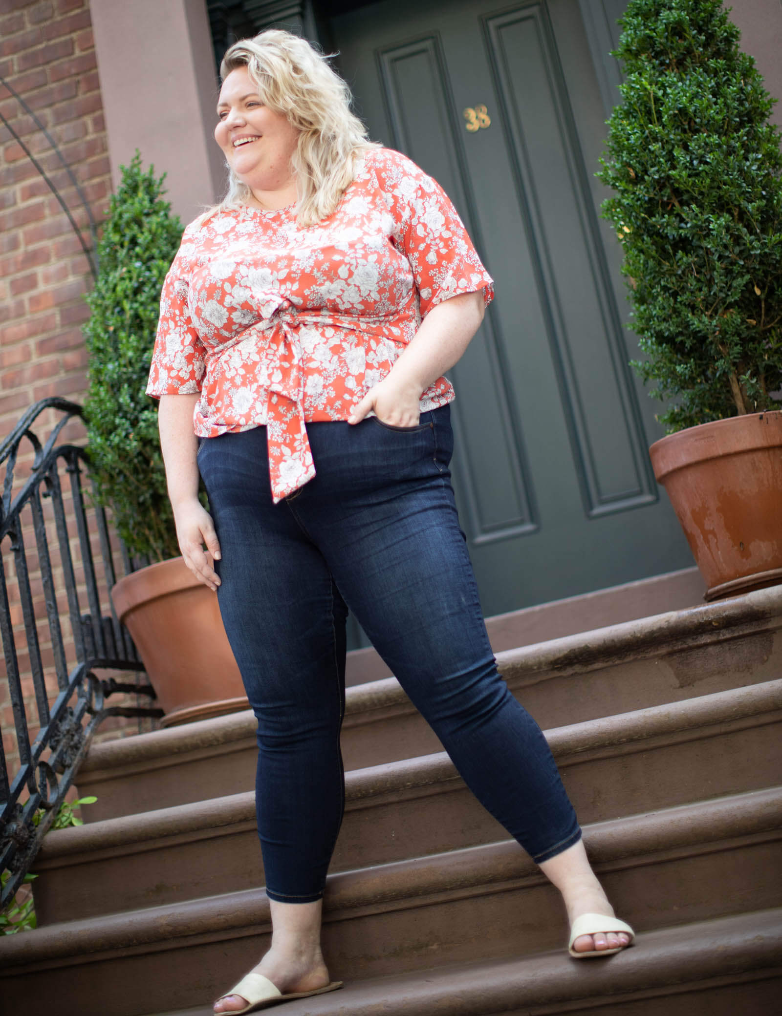 sean in plus-size jeans and a orange floral tie-waist top