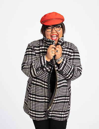 virgie tovar in plus size plaid jacket and red hat