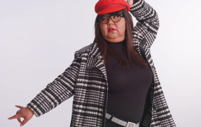virgie tovar wearing plus size outfit