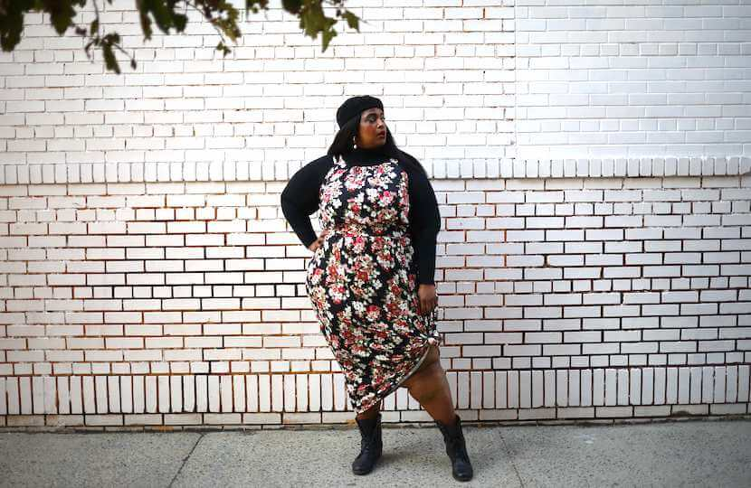Woman wearing floral maxi dress plus-size outfit.